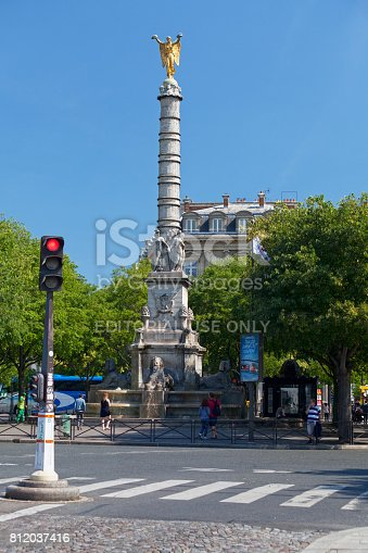 Paris, France - July 07 2017: The Fontaine du Palmier (1806-1808) or Fontaine de la Victoire is a monumental fountain toped with the Statue of Victory, located in the Place du Châtelet, between the Théâtre du Châtelet and the Théâtre de la Ville, in the First Arrondissement of Paris.