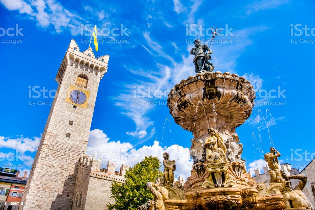 Fontana del Nettuno (Neptune fountain) in Trento and the Torre Civica or Torre di Piazza stock photo