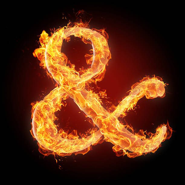 fonts and symbols in fire for different purposes - ampersand stock pictures, royalty-free photos & images