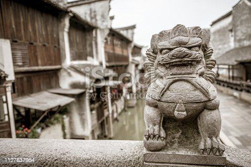 close up of foo dog or lion in Wuzhen water town in china