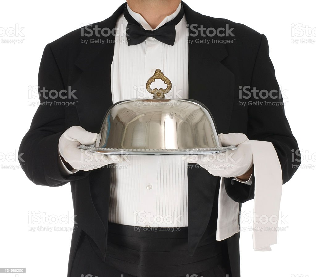 Food and beverages being served by a butler  stock photo