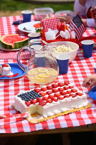 Food and decorations on the table at a 4th of July barbecue stock photo