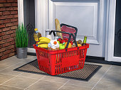 istock Food and eats online buying and delivery concept. Shopping basket with grocery in front of door. 1264844312