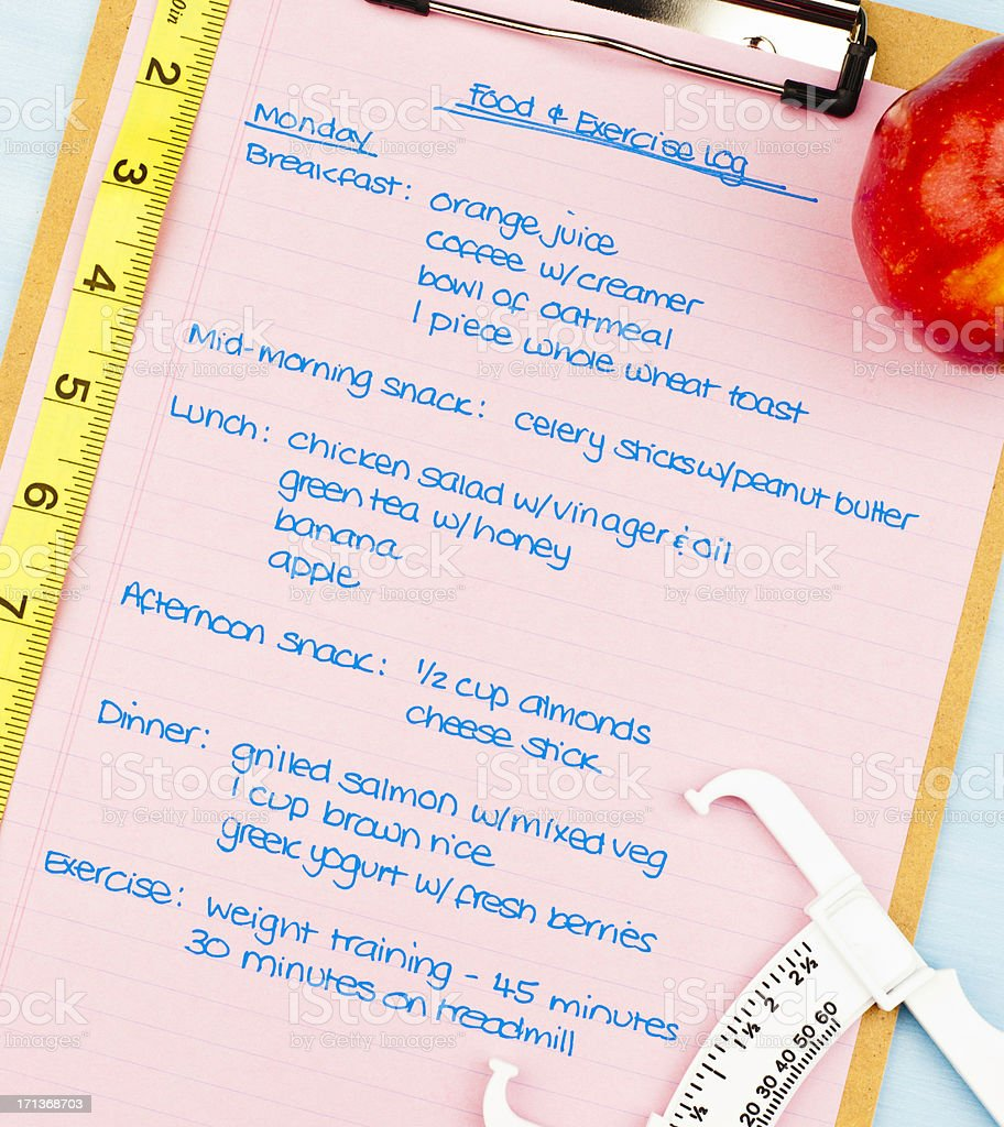 Food and Exercise Log stock photo