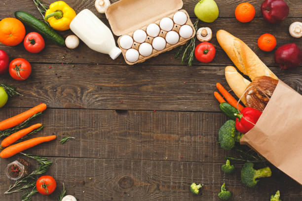 Food and fresh ingredients on wooden table with copy space stock photo