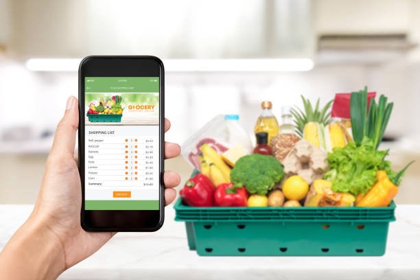 food and grocery online shopping application on smartphone screen - icona supermercato foto e immagini stock