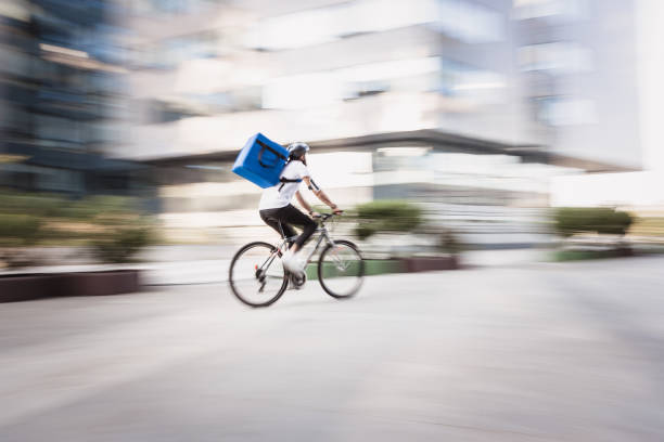 Food and supplies delivery man in motion blur stock photo