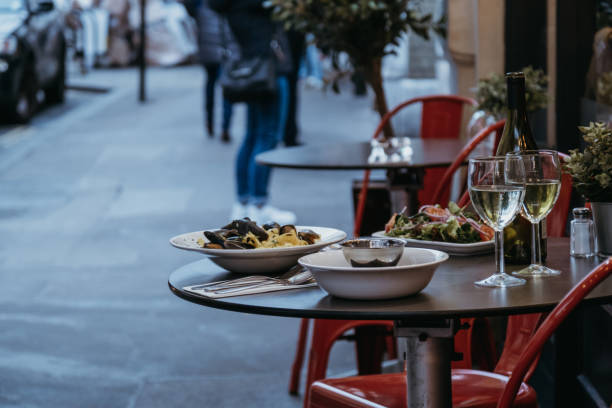 food and wine on the outdoor table of a restaurant, selective focus. - ambientazione esterna foto e immagini stock