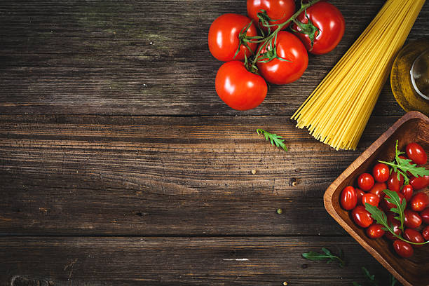 Food background: fresh cooking ingredients on wooden backdrop stock photo