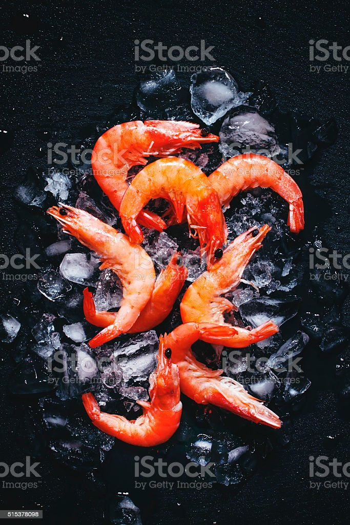 Food background, frozen cooked shrimp with ice stock photo