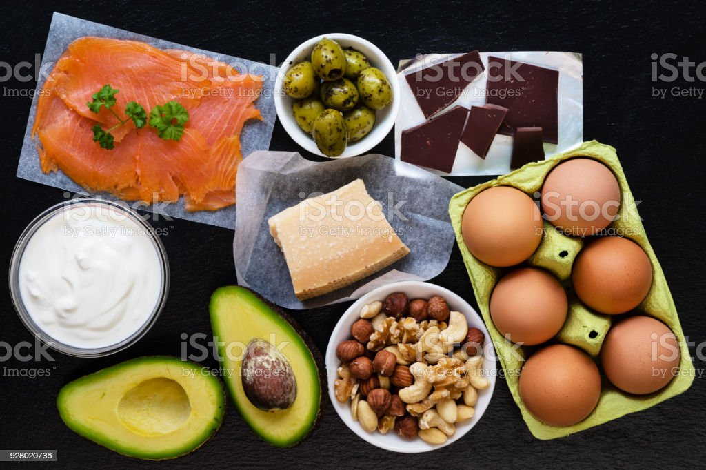 This is a table top shot of food items high in healthy fats. Eating...