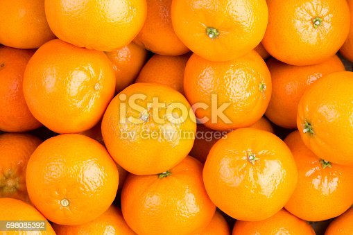 Food background of fresh healthy ripe orange clementines, tangerines or mandarins in a full frame view rich in vitamin c