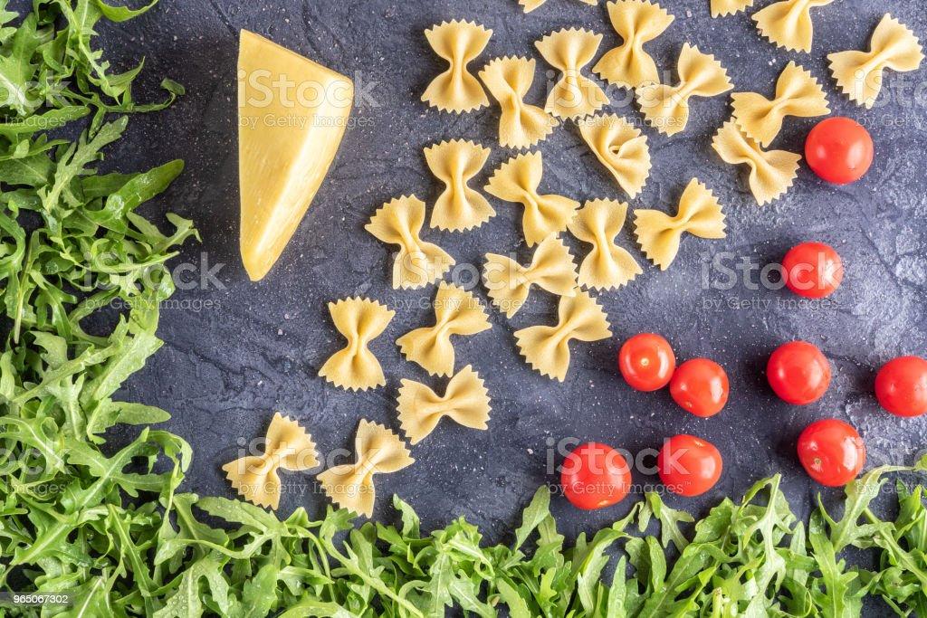 Food background Uncooked Pasta Macaroni Farfalle zbiór zdjęć royalty-free