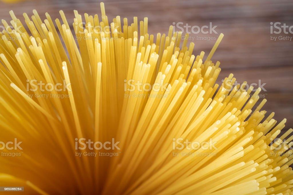 Food background Uncooked Pasta Macaroni Spaghetti Cappellini zbiór zdjęć royalty-free