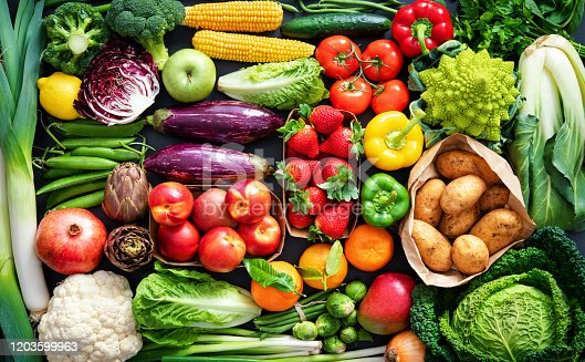 istock Food background with assortment of fresh organic fruits and vegetables 1203599963