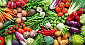 istock Food background with assortment of fresh organic vegetables 1203599923
