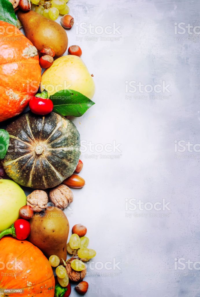 Food background with pumpkins, vegetables, fruits and nuts stock photo