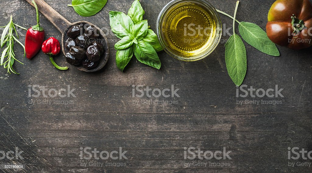 Food background with vegetables, herbs and condiment. Greek black olives stock photo