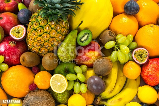 istock Food Backgrounds - many different healthy organic fruits 878887866
