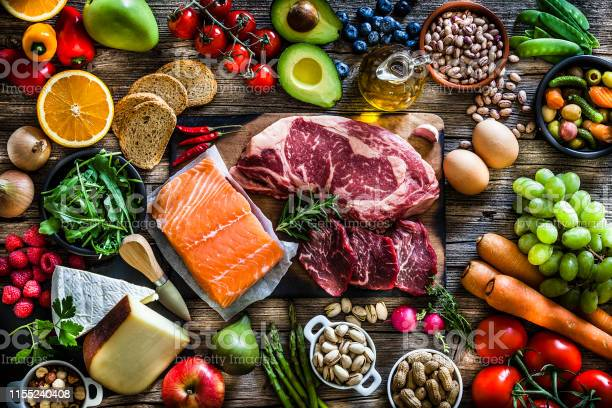 Food Backgrounds Table Filled With Large Variety Of Food - Fotografie stock e altre immagini di Abbondanza