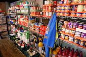 istock Food bank shelving filled with donated tinned food ready for distribution 1264978202