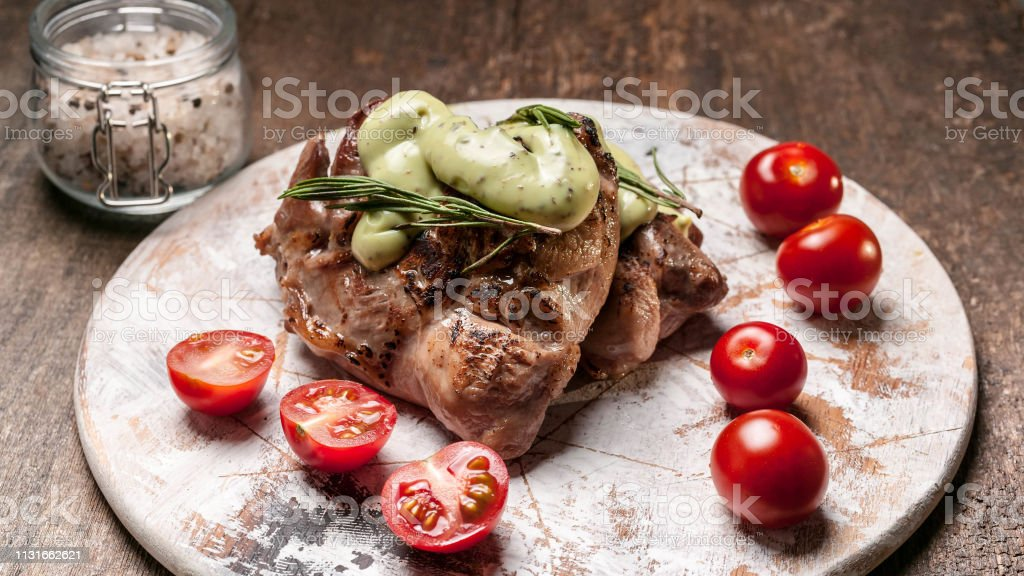 Food banner. Roasted turkey meat with arugula and rosemary sauce on a...