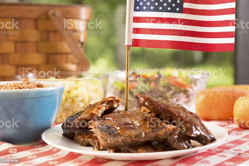 Food: Barbecue ribs, beans, potato salad and an American flag. royalty-free stock photo
