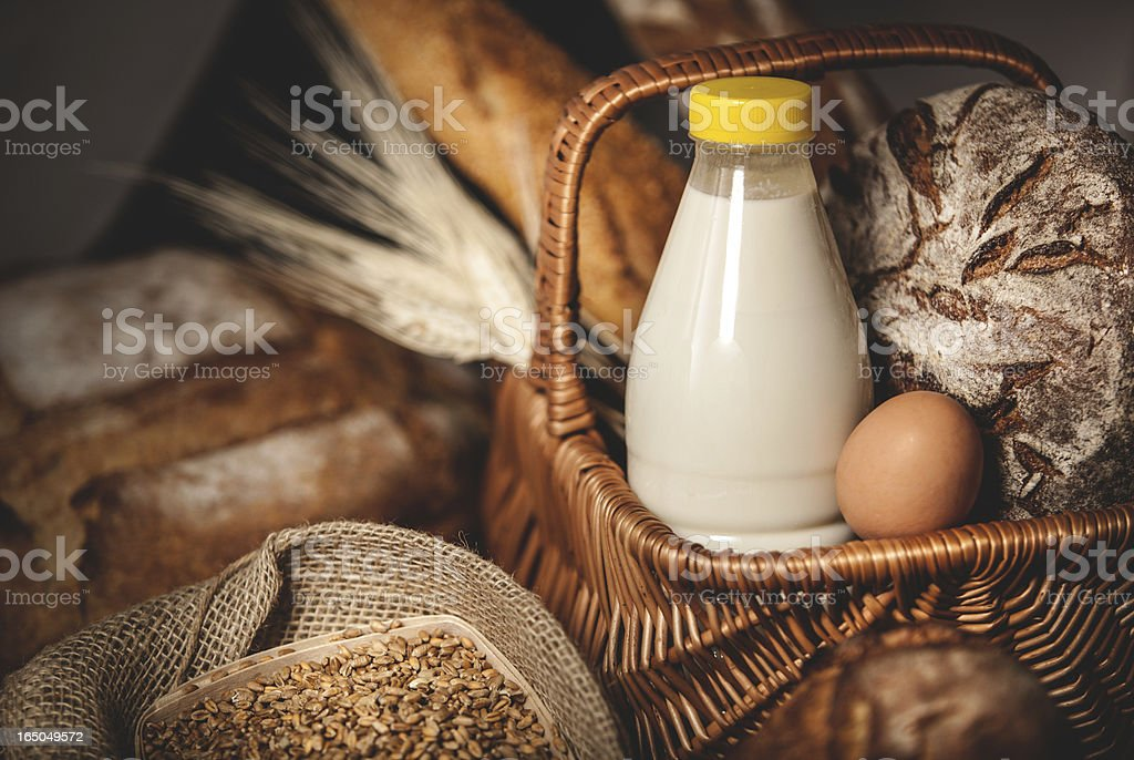 Food basket dairy products, bread and eggs. stock photo