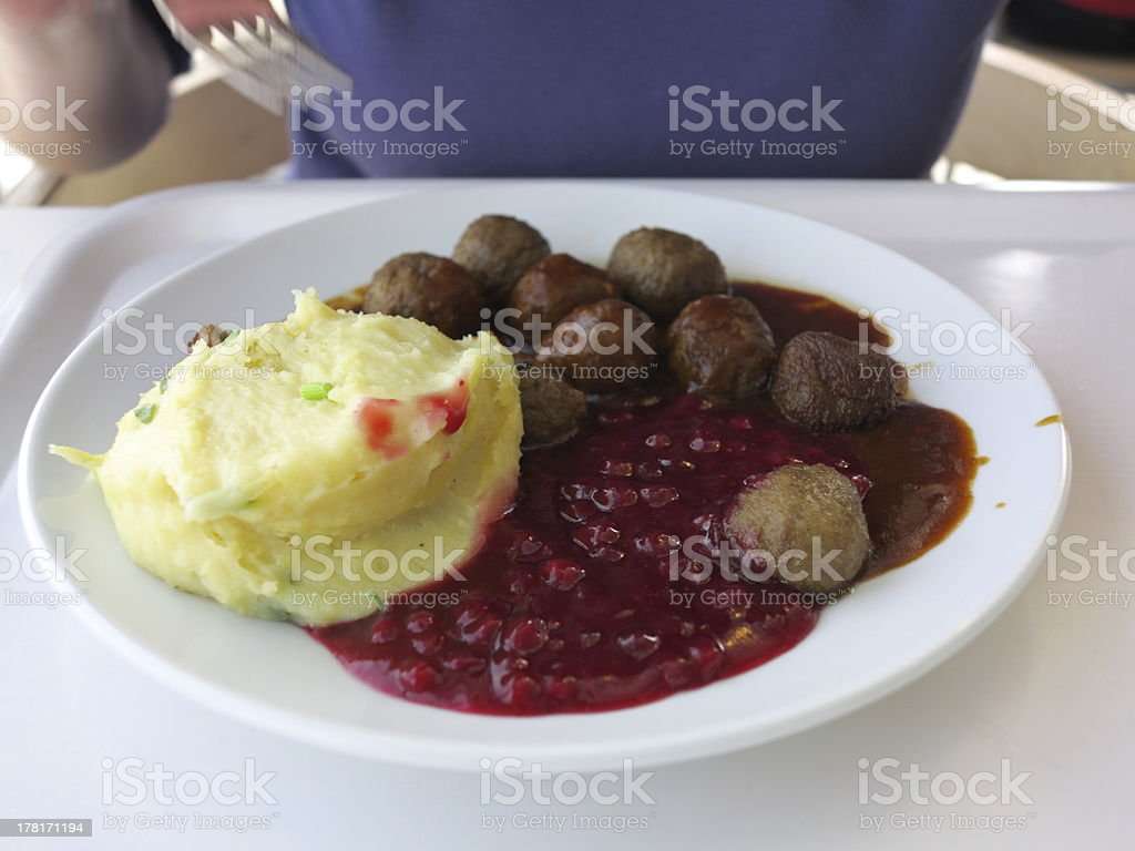 Food being eaten. Dinner meatballs with potatoes. royalty-free stock photo