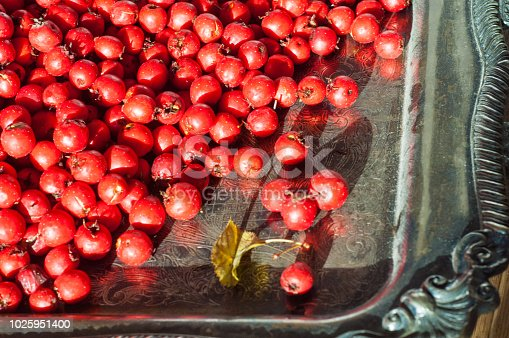 istock Food. berries. Hawthorn bright red ripe harvested for jam, drying, frosting. Autumn is the time of conservation. 1025951400