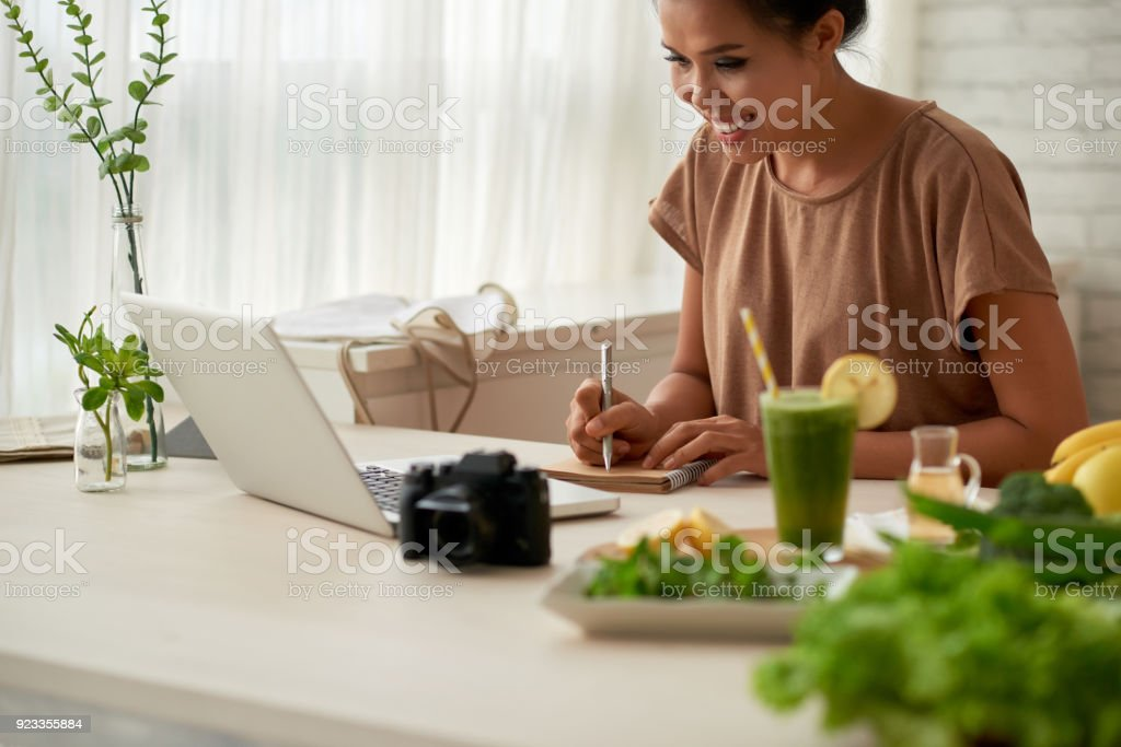 Food blooger planning work stock photo