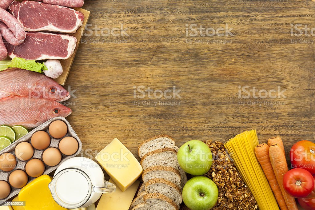 Food border on rustic wood table shot from above stock photo