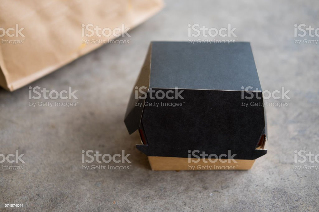 Food box, packaging for hamburger on concrete background - Photo