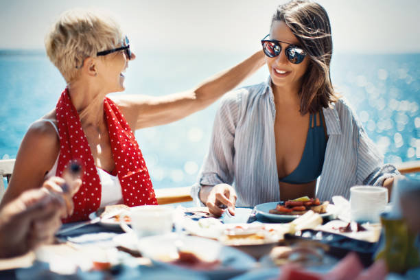 food brings us together. - yacht front view stock photos and pictures