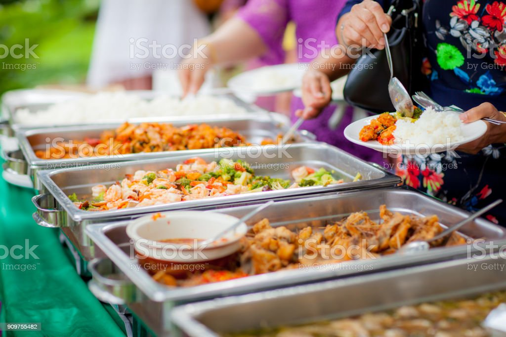 Food Buffet Catering Dining Eating Party Sharing Concept.people group catering buffet food indoor in luxury restaurant stock photo