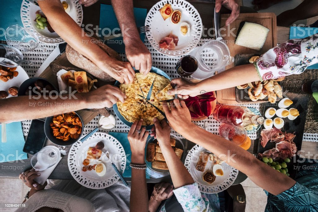 Food Catering Cuisine Culinary Gourmet Party Cheers Concept friendship and dinner together. mobile phones on the table, pattern and background colorful image with people eating and taking food during an event - foto stock