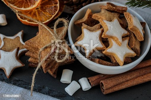 istock Food Christmas decorations - gingerbread cookie on dark background. Homemade christmas cookies 1285459861
