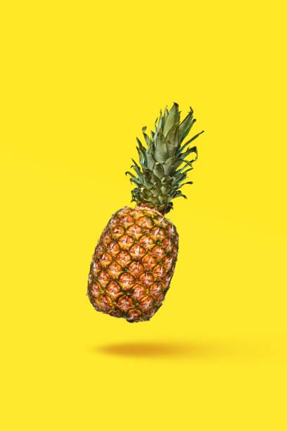 Food composition of ripe pineapple and halved fruit on a blue with picture id1222064841?b=1&k=6&m=1222064841&s=612x612&w=0&h=vxf8 zviomd b8dvzdqpr14cvgmobghud od2n6k8yg=