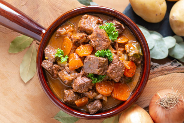 Food concept french classic beefs stew estouffade de boeuf with copy space Food concept french classic beefs stew estouffade de boeuf with copy space goulash stock pictures, royalty-free photos & images