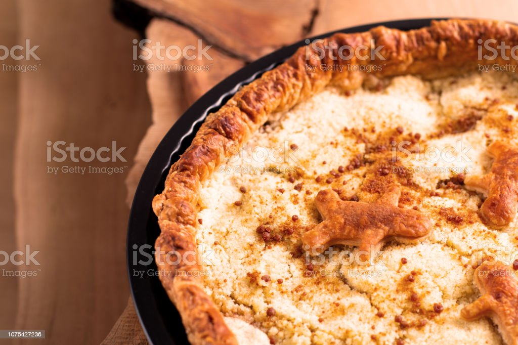 Food concept fresh baked homemade Apple crumble pie in pan on wooden background with copy space stock photo