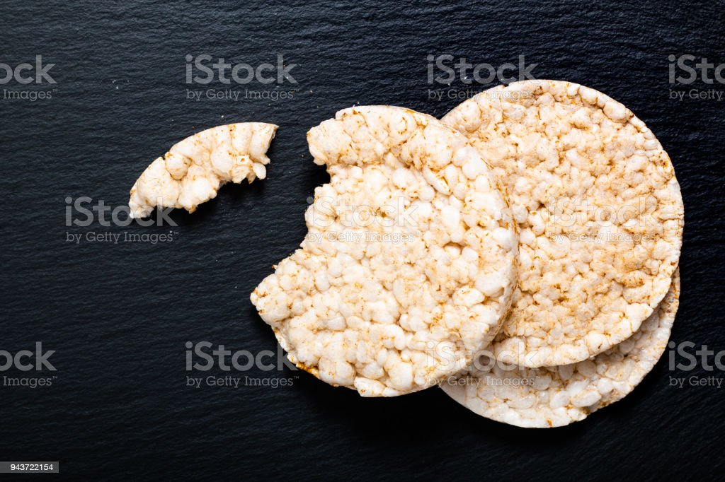 Food concept Rice cracker oe Rice cake on black slate stone plate with copy space stock photo