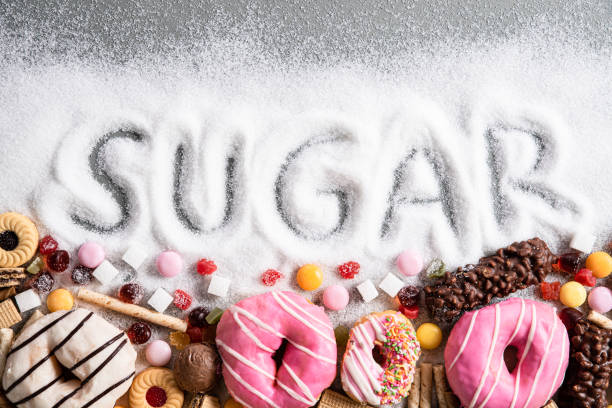 food containing sugar. mix of sweet donuts, cakes and candy with sugar spread and written text in unhealthy nutrition, chocolate abuse and addiction concept, body and dental care. - açúcar imagens e fotografias de stock
