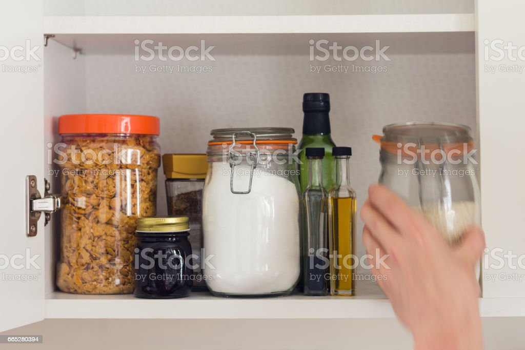 food cupboard with jars stock photo