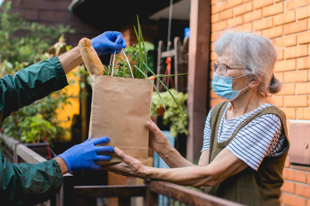 food delivered to elderly person during epidemic lockdown isolation stock photo