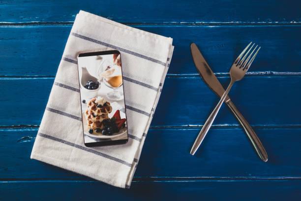 food delivery concept with a digital tablet - food delivery стоковые фото и изображения