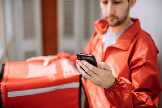 Food delivery man getting ready for work stock photo