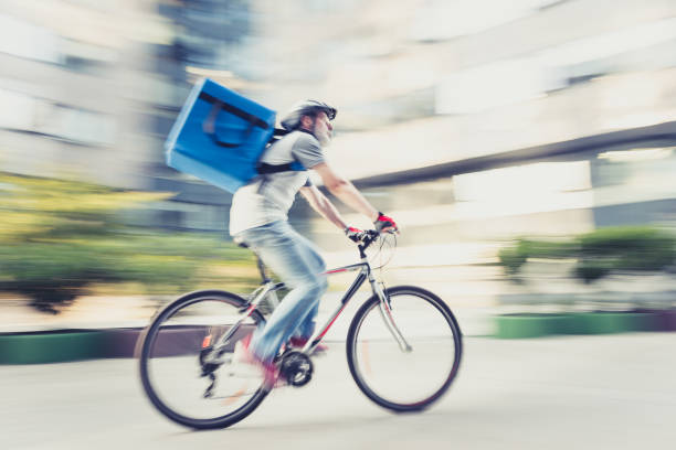 Food delivery on bicycle stock photo