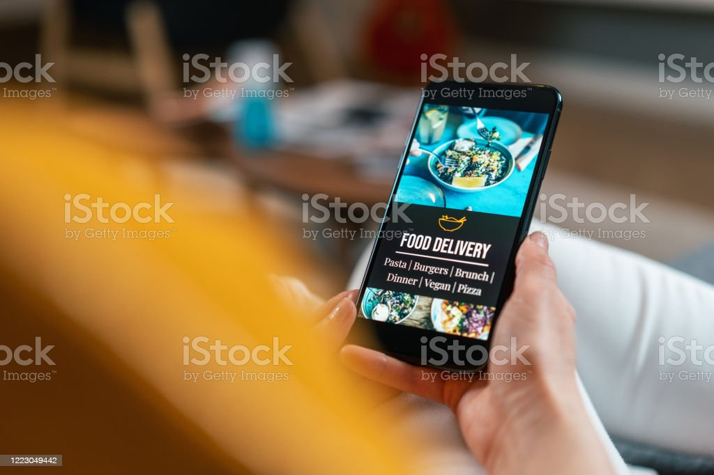 Food delivery Unrecognizable person with smartphone ordering food online Adult Stock Photo