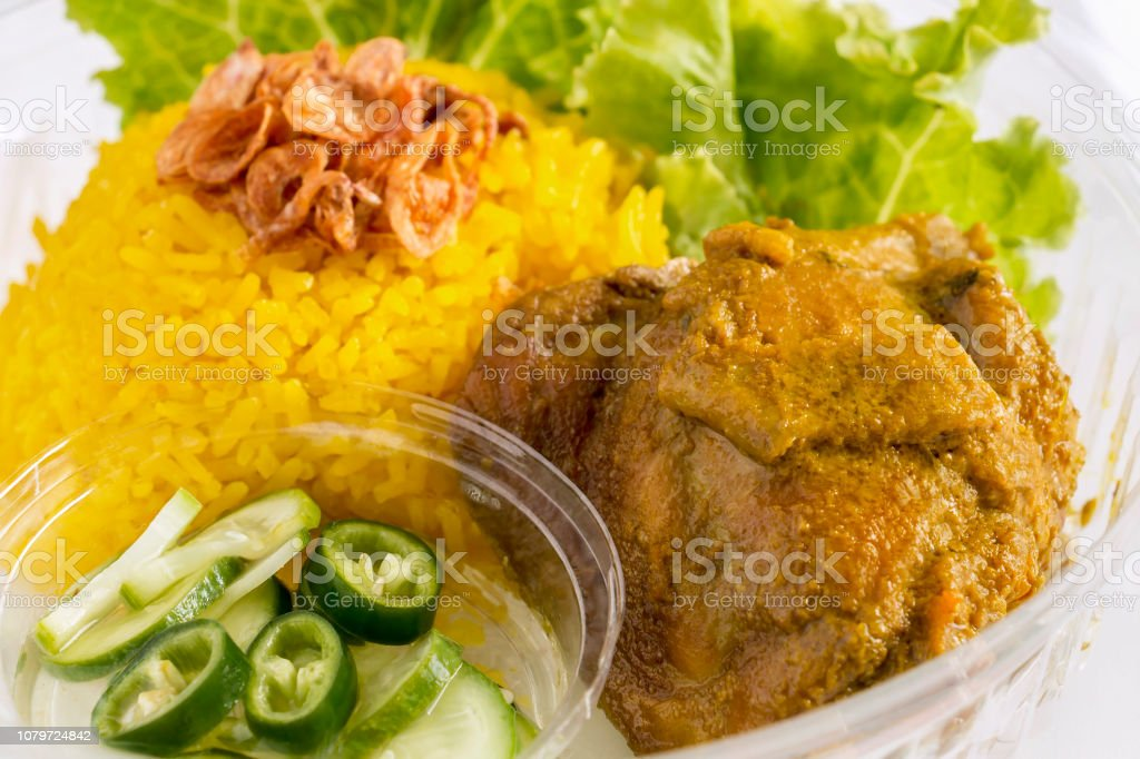 Chicken Biryani opening cling wrap and take out food in plastic...