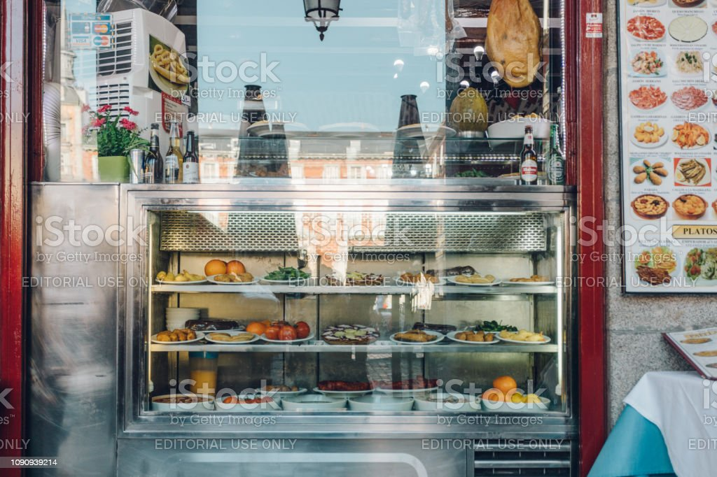 food displayed in a storefront stock photo